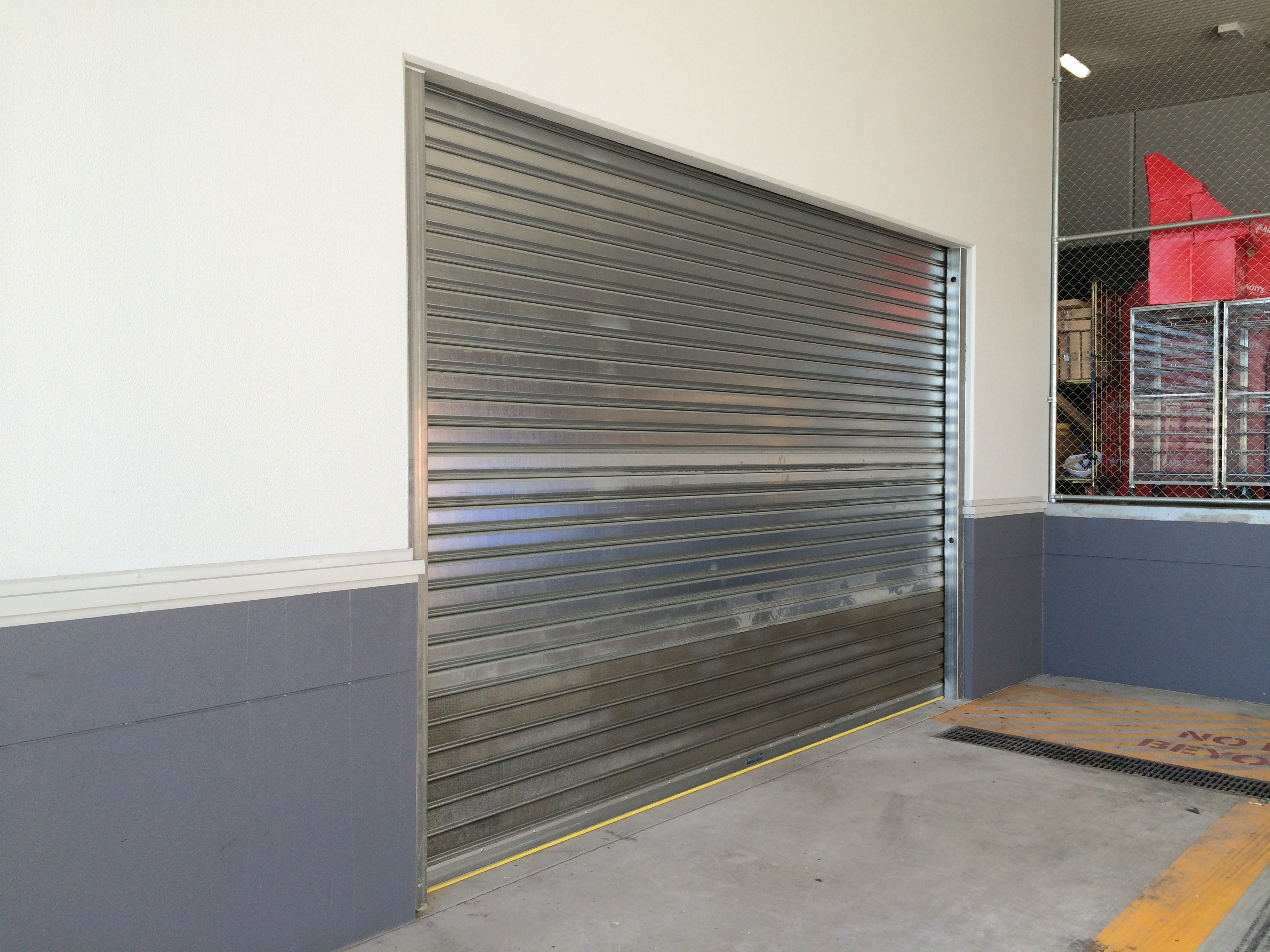 7f16961a ... ventilation perforations to the Coles Shop front and galvanised  motorised steel S100 shutters to the loading dock and bin rooms, while the  Clearline ...