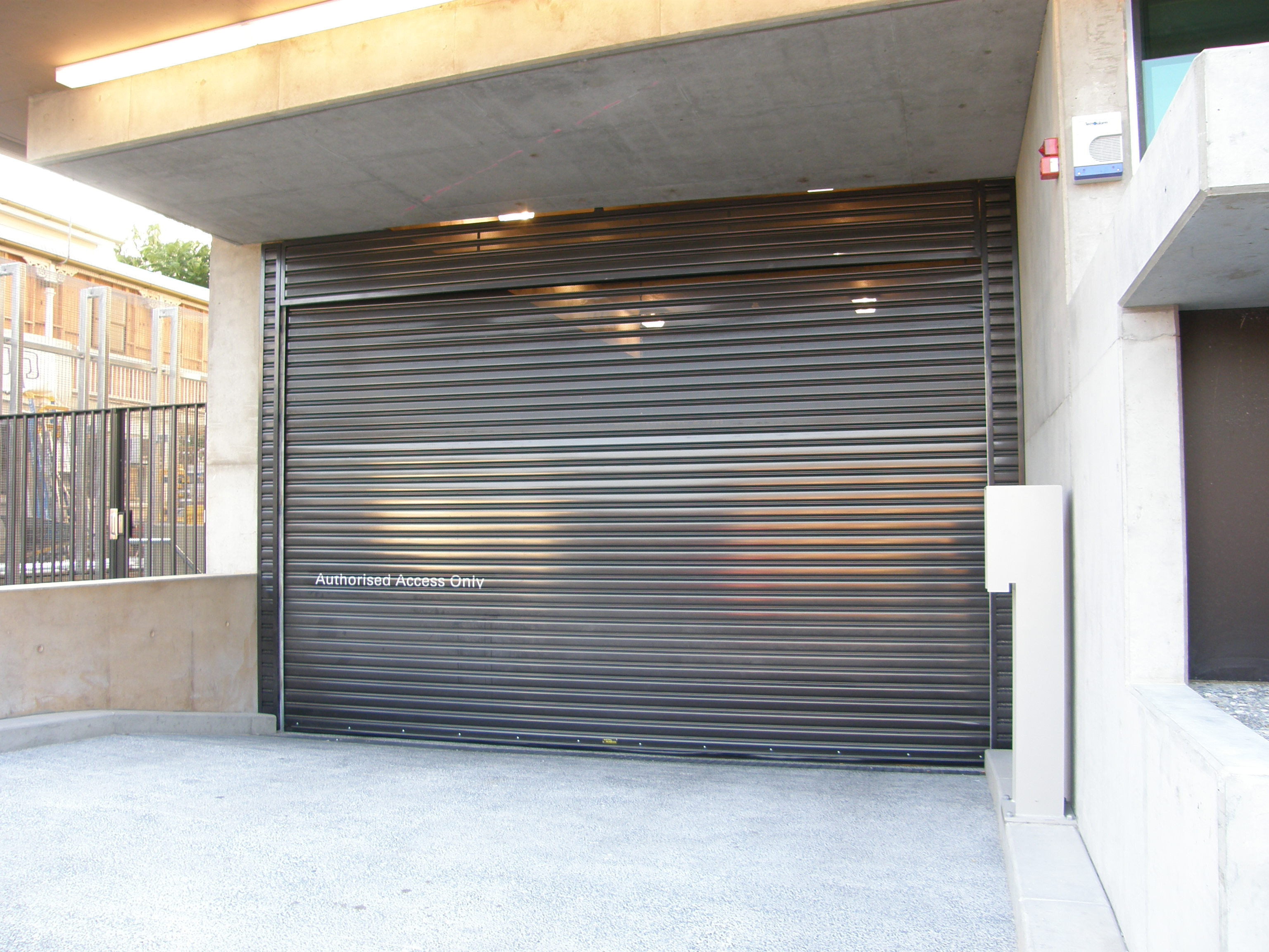 s100 steel roller shutters high cycle mirage doors. Black Bedroom Furniture Sets. Home Design Ideas